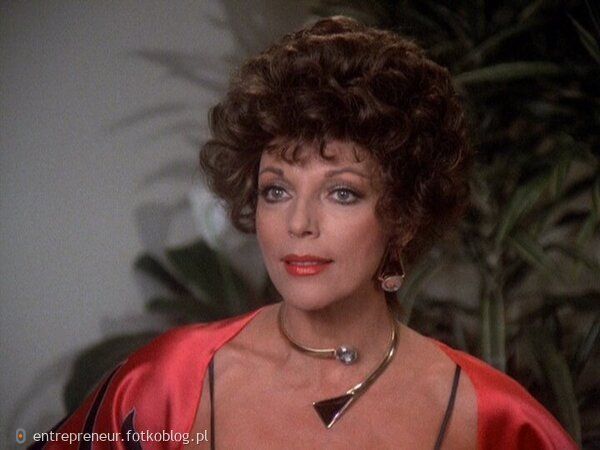 Joan Collins as Alexis 56